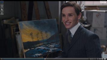 Einar davanti al suo quadro, rappresentante un luogo dell'infanzia